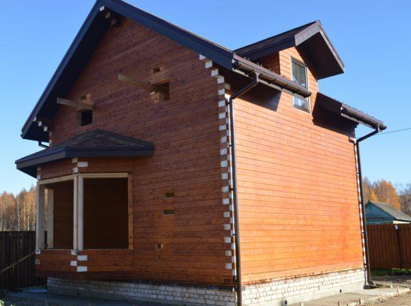 Полутораэтажный дом из профилированного бруса 145х195
