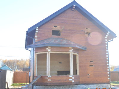 Дом из профилированного бруса 145х195 мм с эркером